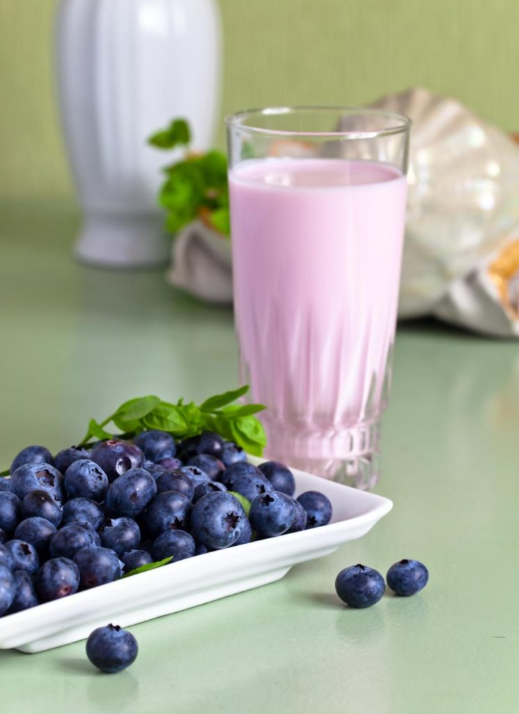 blueberry yogurt and berries on a kitchen table